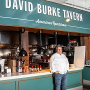 Chef David Burke stands in front of David Burke Tavern Time Out Market New York located in Brooklyn