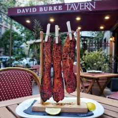 Outdoor Dining Table at David Burke Tavern. Maple Bacon is on the Table.