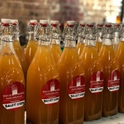 Apple Cider Bourbon in 34oz glass bottles with resealable swing lids.